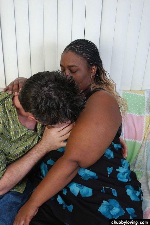 Fat black woman Lyric giving ball biting BJ before riding cock