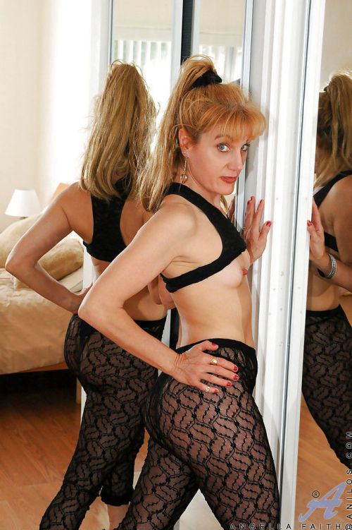 Mature redhead Angella Faith stripping from embroidered pantyhose and masturbating
