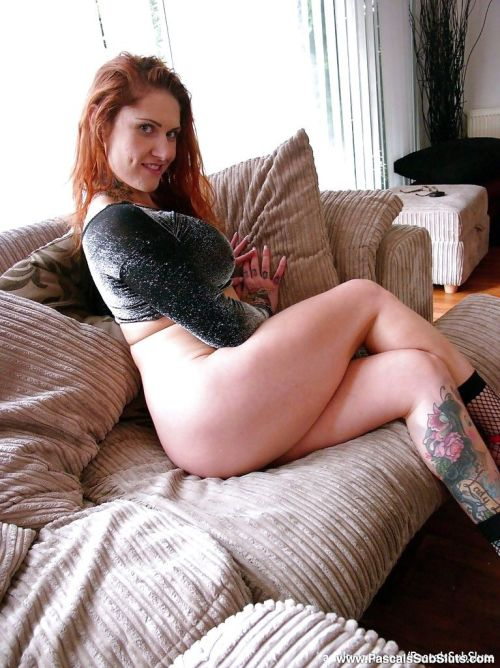 Inked Euro amateur Tallulah Tease baring ass and snatch in mesh socks