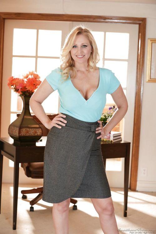 Sexy blonde mature Julia Ann strips short skirt & thong to display huge boobs