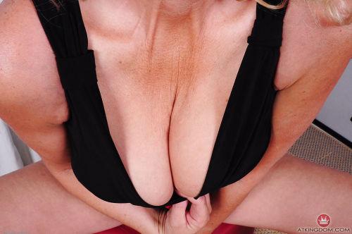 Older blonde model Lady Dalbin undressing for spreading of granny pussy