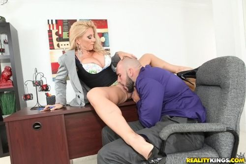 Mature boss lady demands that her employee eat her pussy before fucking her