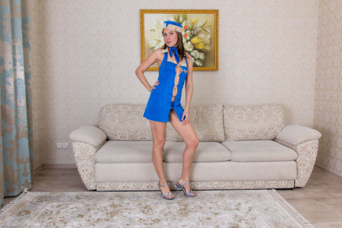 Middle aged dame Loredana sheds her sexy uniform before stretching her beaver
