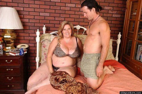 Obese mature woman Deedra takes cumshot on fat tits and eats jizz