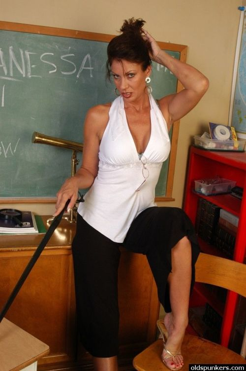 Mature teacher Vanesa strips naked in class for a nice shag