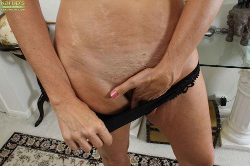 Older blonde amateur Cally Jo modeling naked after removing clothes - part 2